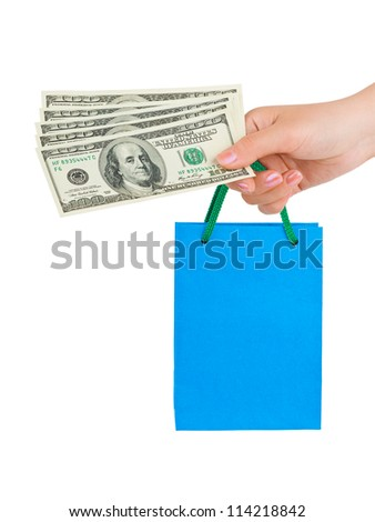 Hand with money shopping bag isolated on white background - stock photo
