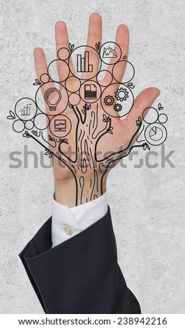 hand with money tree on gray background - stock photo