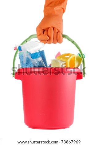 hand with orange glove carry many cleaning products in red bucket