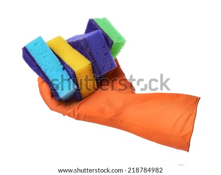 Hand with orange rubber glove holds sponges isolated on white background