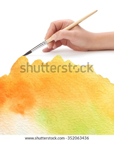 hand with paint brush and color painted background - stock photo