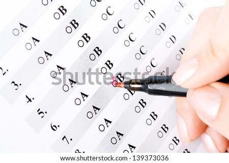 Hand with pen and test with a mark isolated - stock photo