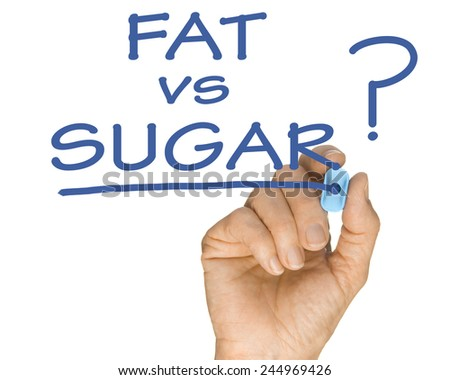 Hand with Pen Drawing Fat vs Sugar Question in accordance with low sugar weightloss lifestyle - stock photo