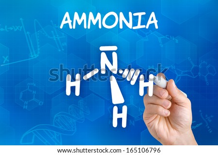 Hand with pen drawing the chemical formula of ammonia - stock photo