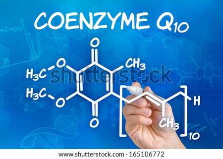 Hand with pen drawing the chemical formula of coenzyme Q10 - stock photo