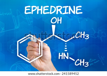 Hand with pen drawing the chemical formula of ephedrine - stock photo