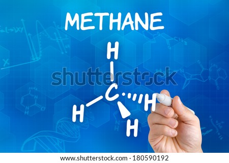 Hand with pen drawing the chemical formula of methane - stock photo