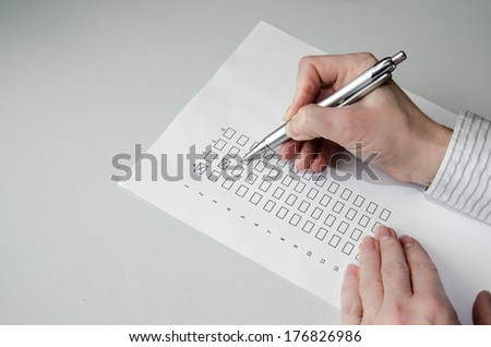 hand with pen filling in a questionnaire