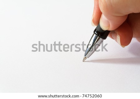 hand with pen over blank paper