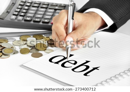 Hand with pen pointing to debt word on the paper - business  and financial concepts - stock photo