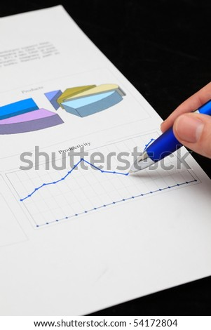 Hand with pen showing diagram - stock photo