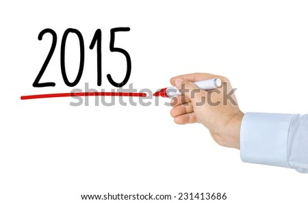 Hand with pen writing 2015 - stock photo