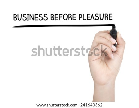Hand with pen writing BUSINESS BEFORE PLEASURE on whiteboard - stock photo