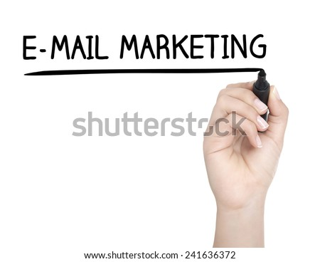 Hand with pen writing E-MAIL MARKETING on whiteboard - stock photo