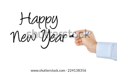 Hand with pen writing Happy New Year