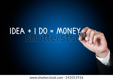Hand with pen writing money concept on whiteboard