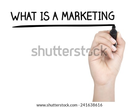 Hand with pen writing WHAT IS A MARKETING on whiteboard - stock photo