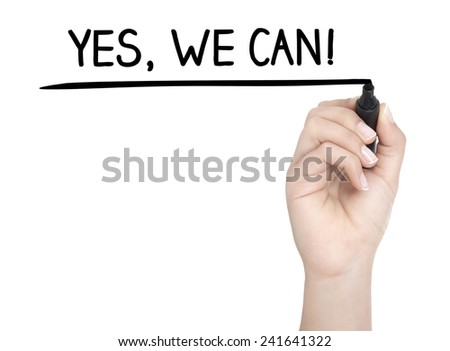 Hand with pen writing YES, WE CAN on whiteboard - stock photo