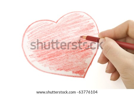 hand with pencil drawing heart