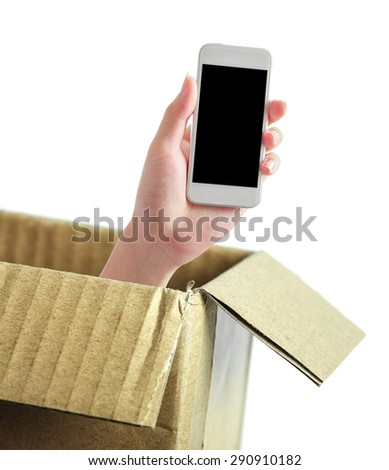 Hand with phone is out of box isolated on white. - stock photo