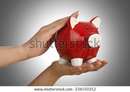Hand with piggybank on white background - stock photo