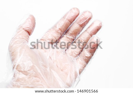 Hand with Plastic gloves on white background - stock photo