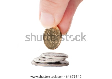Hand with Polish coin isolated on white background
