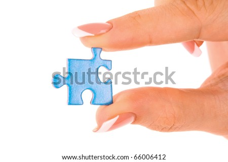 Hand with puzzle isolated on white