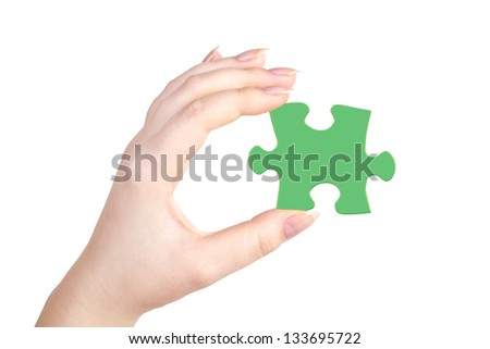 Hand with puzzle isolated on white background.