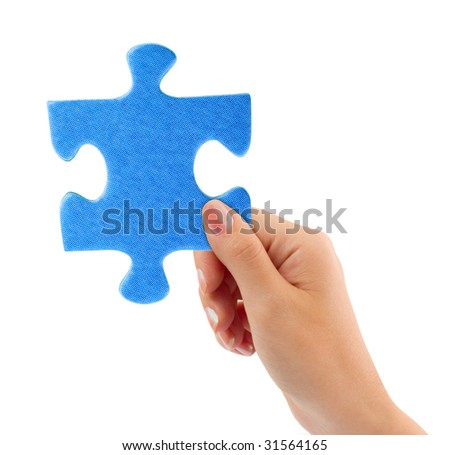 Hand with puzzle isolated on white background - stock photo