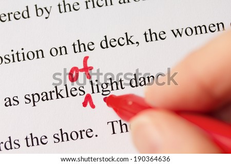 Hand with Red Pen Proofreading Document Text Closeup - stock photo