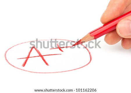 Hand with red pencil and mark A+ isolated on white - stock photo