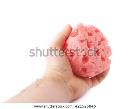 Hand with red pink bathing sponge isolated over the white background - stock photo