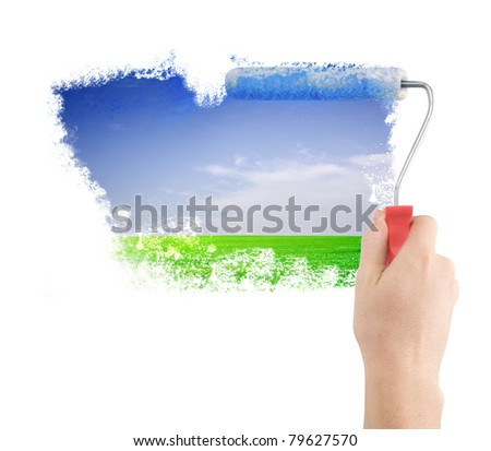 hand with roller paint landscape - stock photo