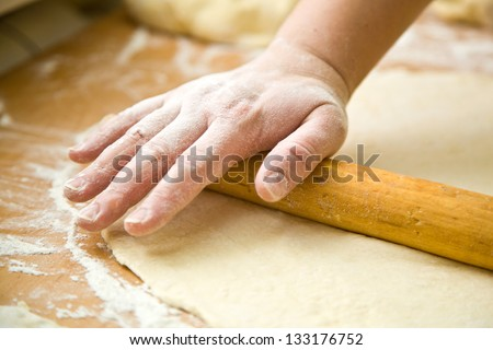 hand with rolling pin and flour - stock photo