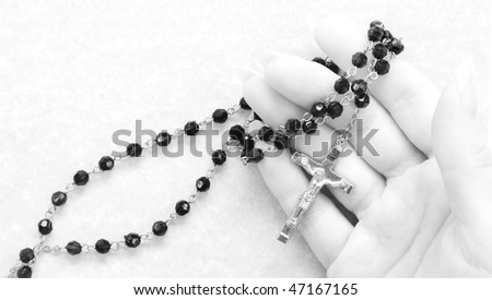hand with rosary - stock photo