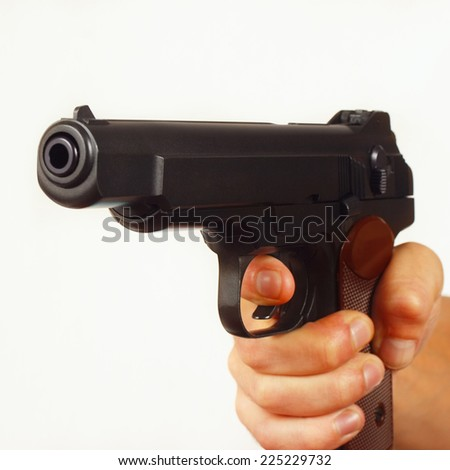 Hand with semi-automatic gun close up - stock photo