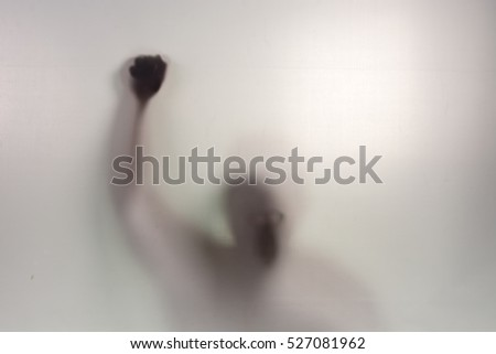 Hand with shaking fist raised up, concept of election, motivated employee, person shouting, achievement, leadership punch, Man behind a screen, Blurry shadow