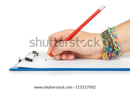 hand with sheet of paper and pencil on clipboard isolated on white background - stock photo