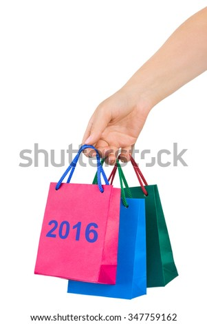 Hand with shopping bags 2016 isolated on white background - stock photo