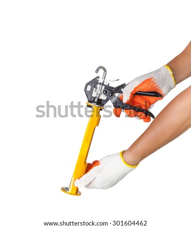 hand with Silicone glue gun, isolated on white - stock photo