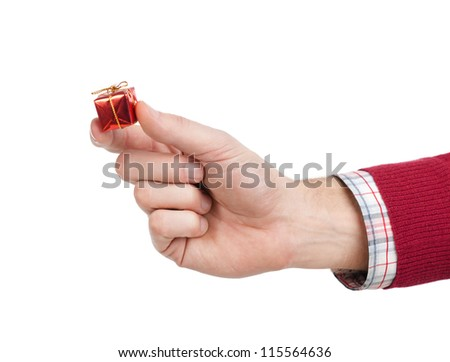 Hand with small toy gift, isolated on white - stock photo