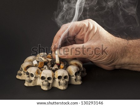 hand with smoke cigarette - stock photo