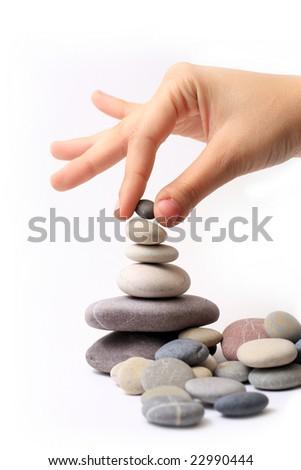 hand with stones - stock photo