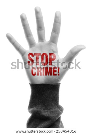 Hand with Stop Crime text is isolated on white background. - stock photo