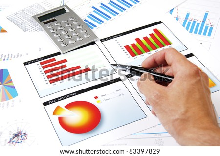 hand with the handle specifies charts of growth, finance business collage - stock photo