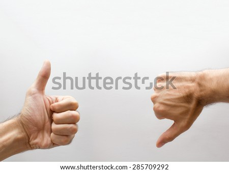 Hand with thumb up and one thumb down  - stock photo