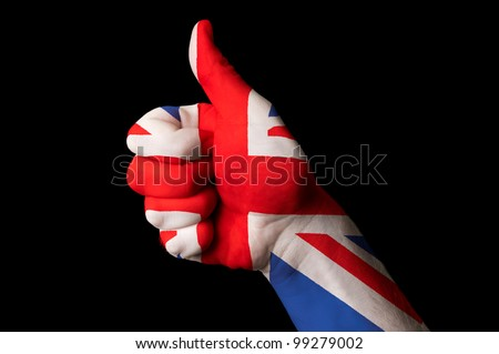 Hand with thumb up gesture colored in great britain national flag as symbol of excellence, achievement, good, - useful for tourism and touristic advertising - stock photo