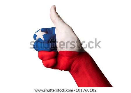 Hand with thumb up gesture in colored chile national flag as symbol of excellence, achievement, good, - for tourism and touristic advertising, positive political, social management of country - stock photo