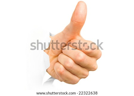 Hand with thumb up has broken through a paper. Isolated. Shallow DOF. - stock photo